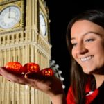 model maker holds tiny lego pumpkins by lego big ben miniland