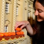 model maker puts tiny lego pumpkins on lego buckingham palace