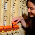 model maker puts tiny lego pumpkins on lego buckingham palace