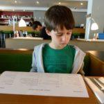 sam reads the menu at canteen at the royal festival hall southbank london