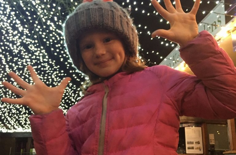 girl reviews the christmas lights at kew gardens london kidrated