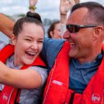 Dad and daughter enjoying their thames rocket boat tour