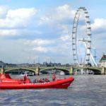 Thames rockets boat stationary near the London Eye