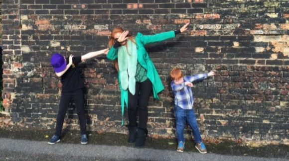 ginger mum amanda fulton dabs with two boys by wall