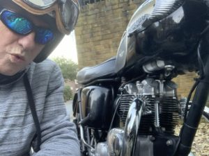 Matthew Wright working on his motorbike