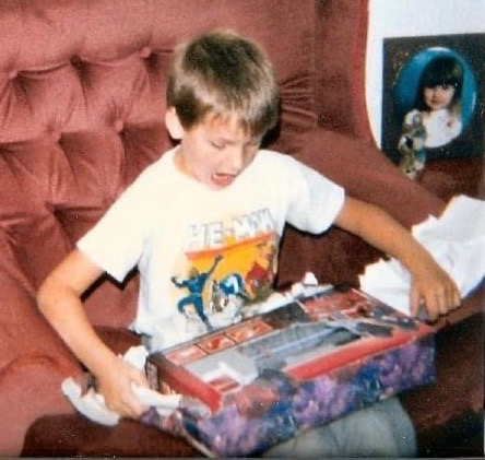 Tony Way as a kid opening a Christmas present