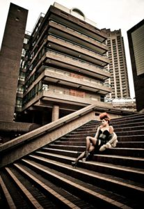 Female punk sitting on the steps of the Barbican, London