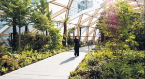 Woman standing at Crossrail Place Roof Garden