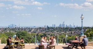 Friends enjoying view of London skyline at Alexandra Palace
