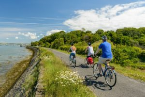 Family cycling down the Tarka Trail, Devon